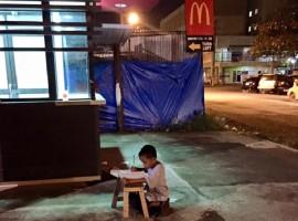 9 Year Old Homeless Boy Doing Homework Outside McDonald's